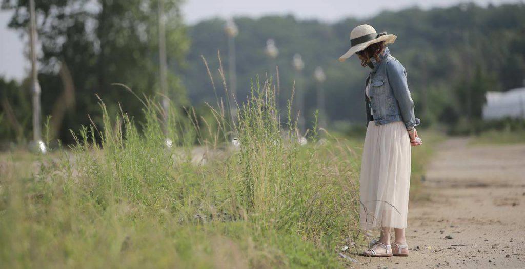 Lady looking at weeds