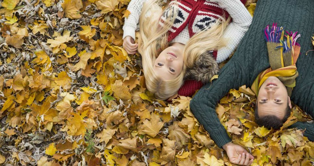 Couple lying in leaves