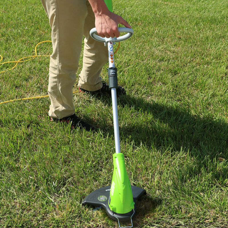 Greenworks 21212 4 Amp 13 Inch Corded String Trimmer in use