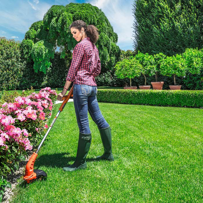 Worx Cordless Weed Trimmer in use