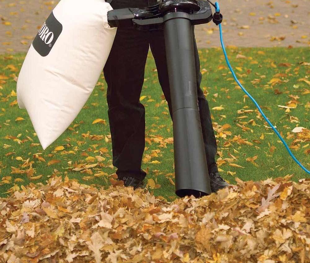 Toro Rake and Vac vacuuming leaves