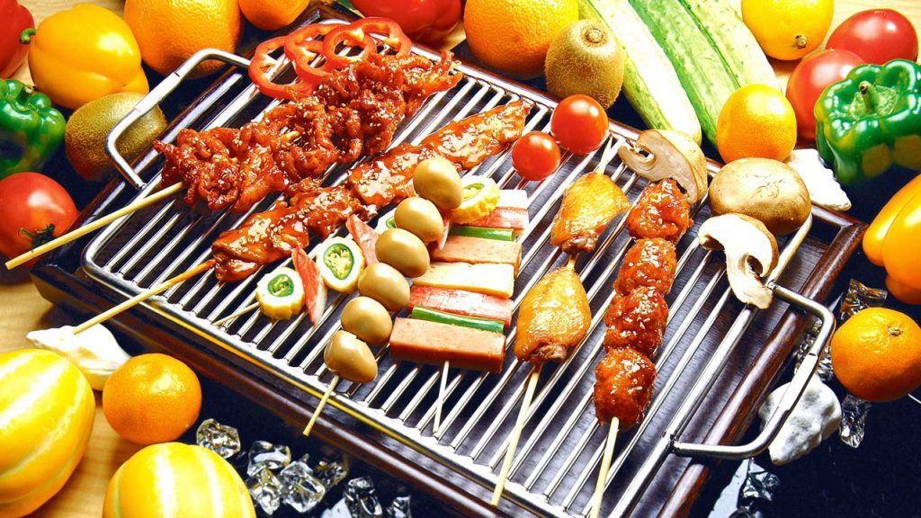 Barbecued food on grill