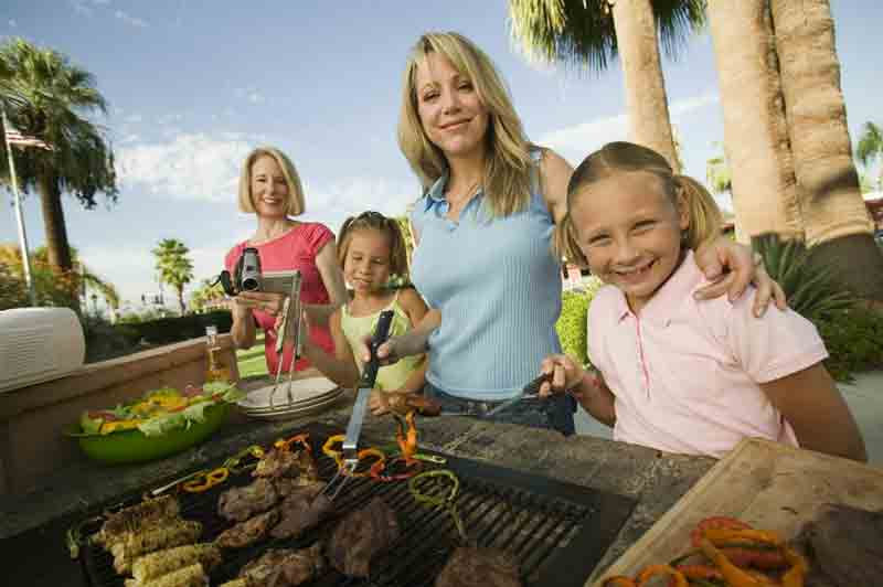 Family in front of barbecue