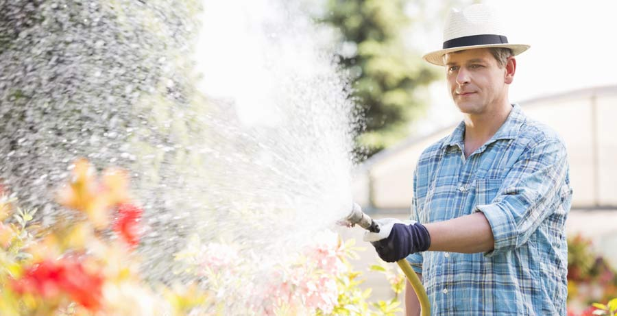 Man with hosepipe