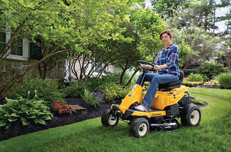Cub Cadet 30 inch riding mower being used