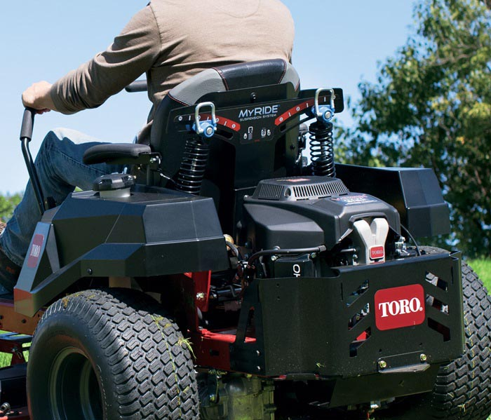 View of man on back of riding mower