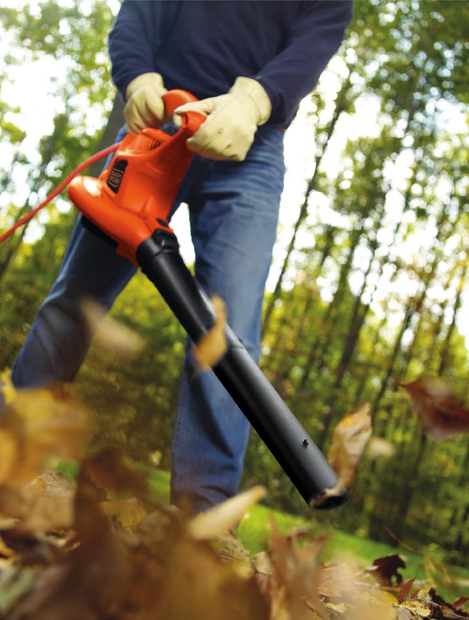 Person using leaf blower
