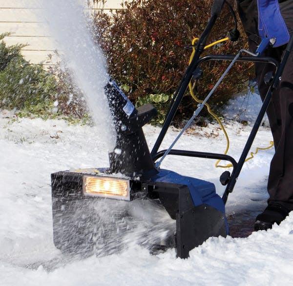 Snow Joe SJ621 Snow Blower in use