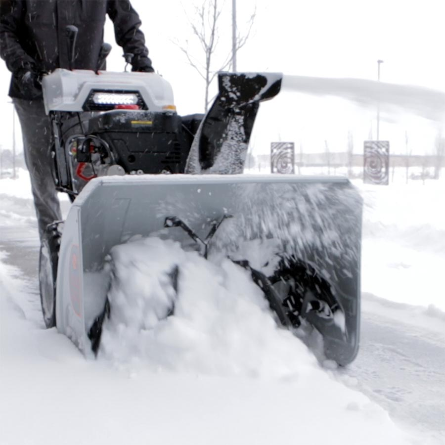 Snow blower pushing snow