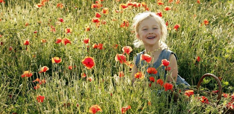 Child in field of flowers