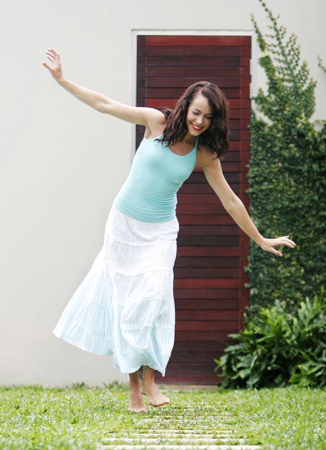 Lady walking barefoot on lawn