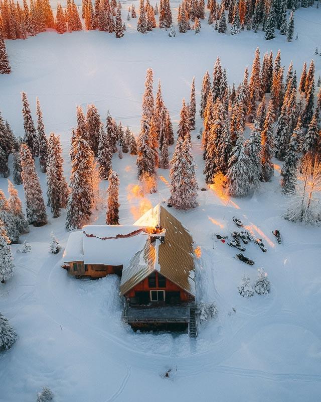 Wooden cabin in forest in winter