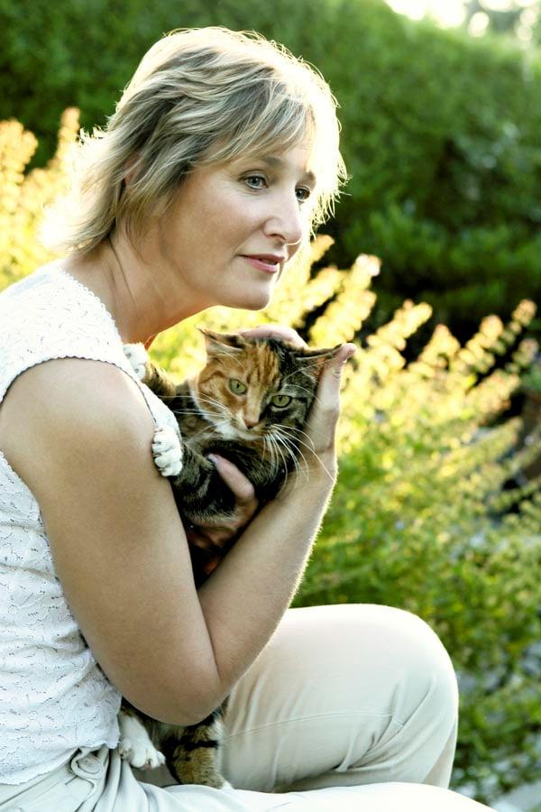 Lady cuddling cat
