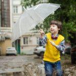Child with umbrella jumping