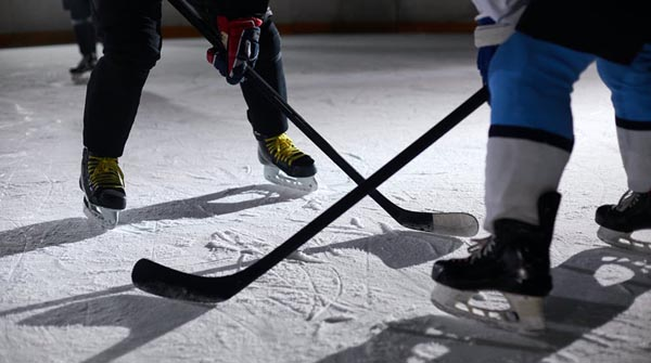 Two people playing hockey