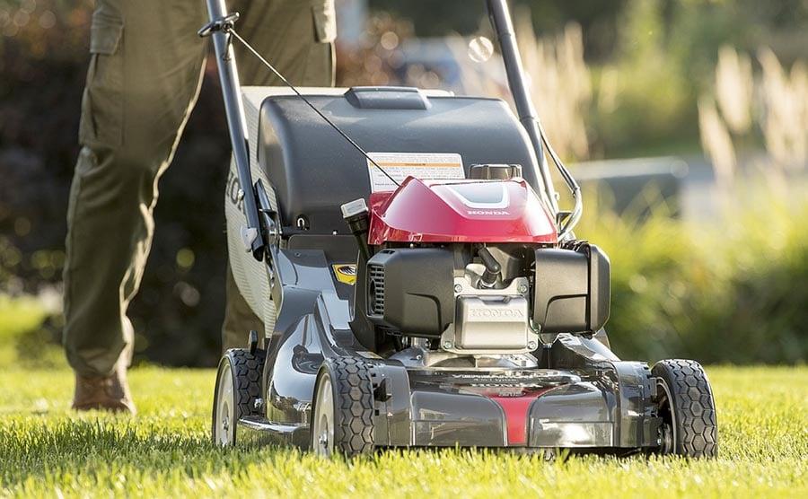 Person pushing lawn mower