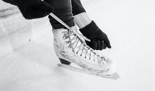 Person lacing up skates