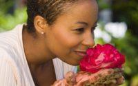 Lady smelling rose
