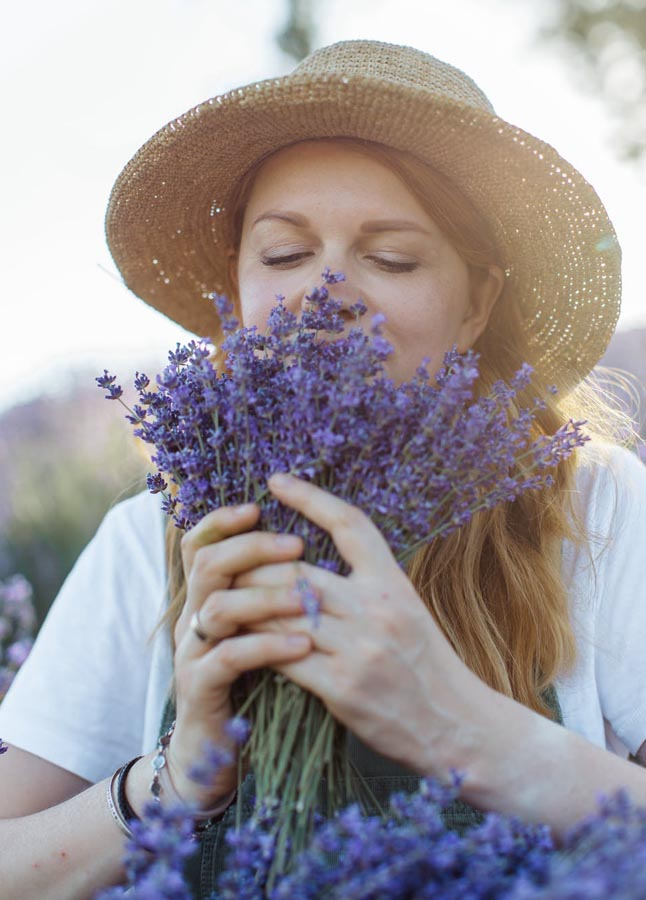 Lady sniffing lavender