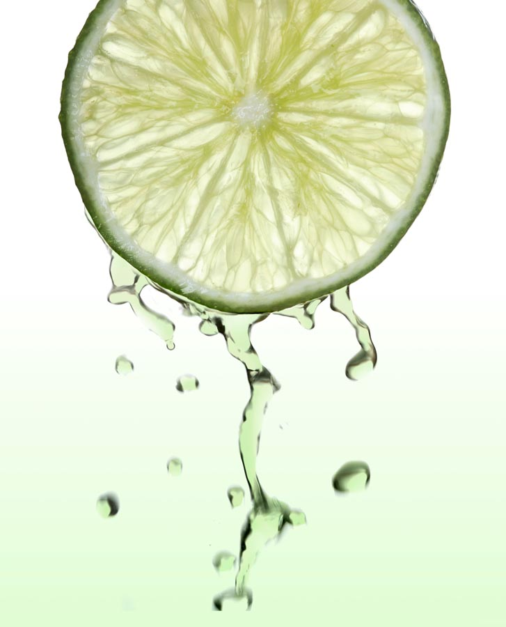 Fresh lime slice with juice drops