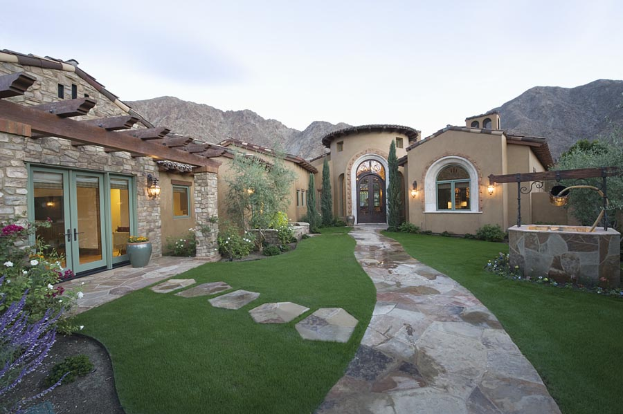 Beautiful house with stone pathway leading to it