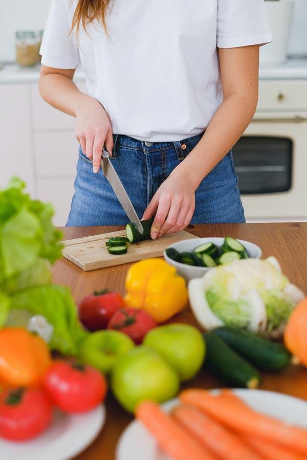Lady slicing zucchini