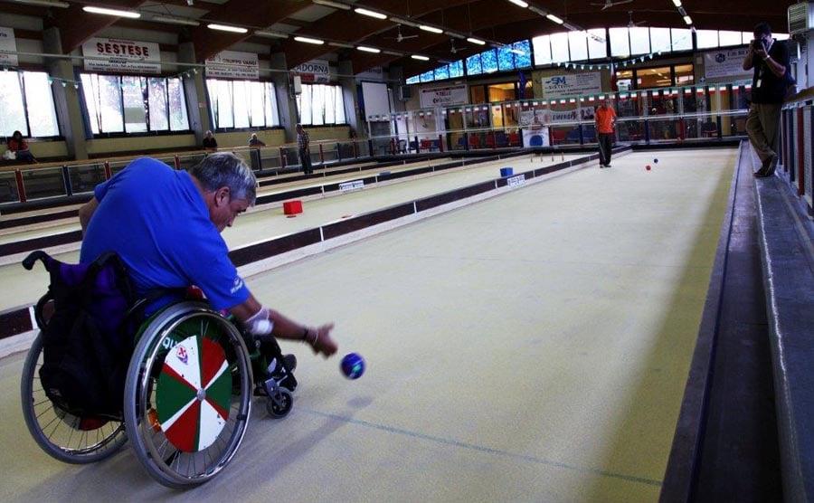 Disabled man playing Bocce Ball