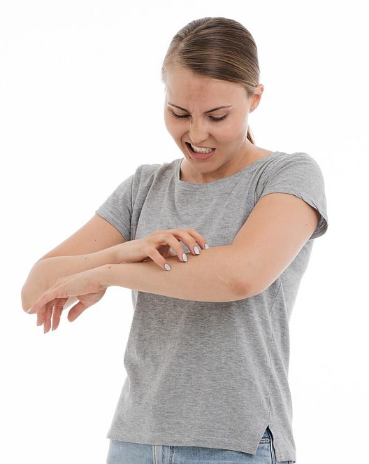 Person itching arm