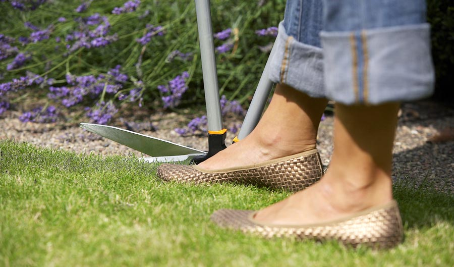Person edging lawn