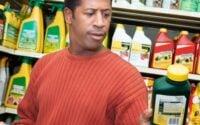 Man holding fertilizer reading label