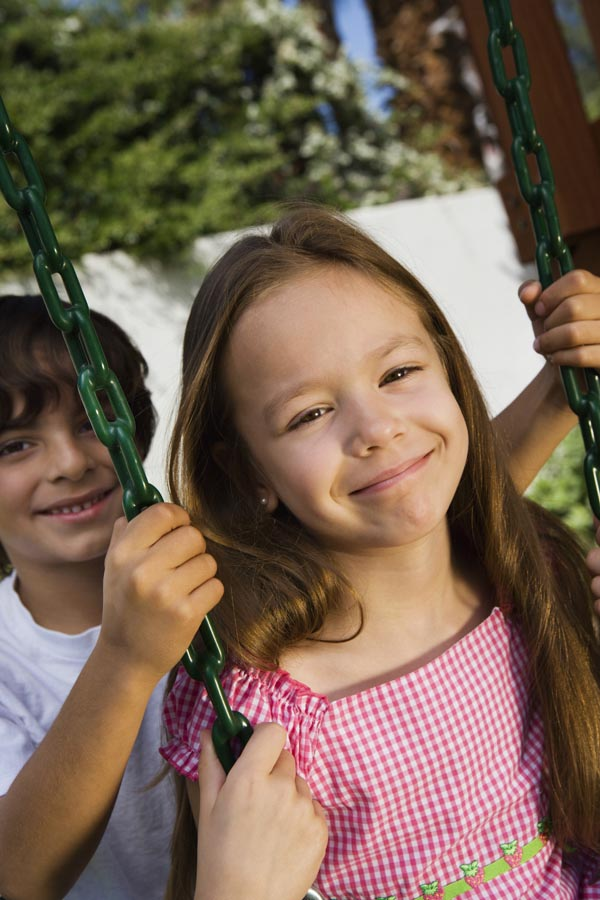 Close up of children on swing