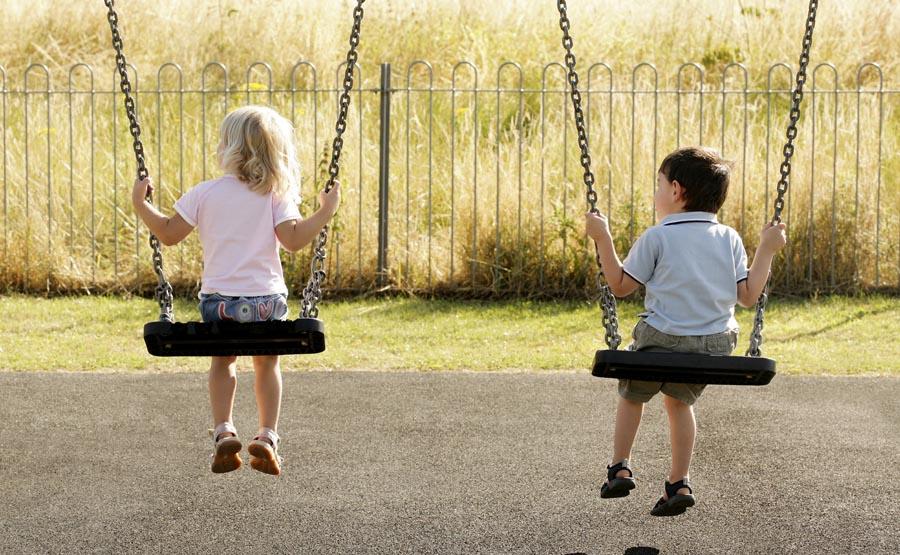 Two children on swings