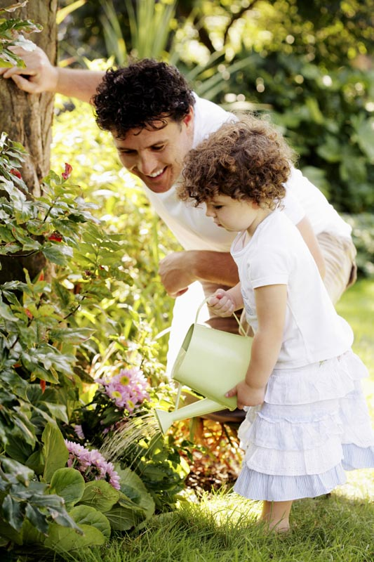Man and daughter looking at plants