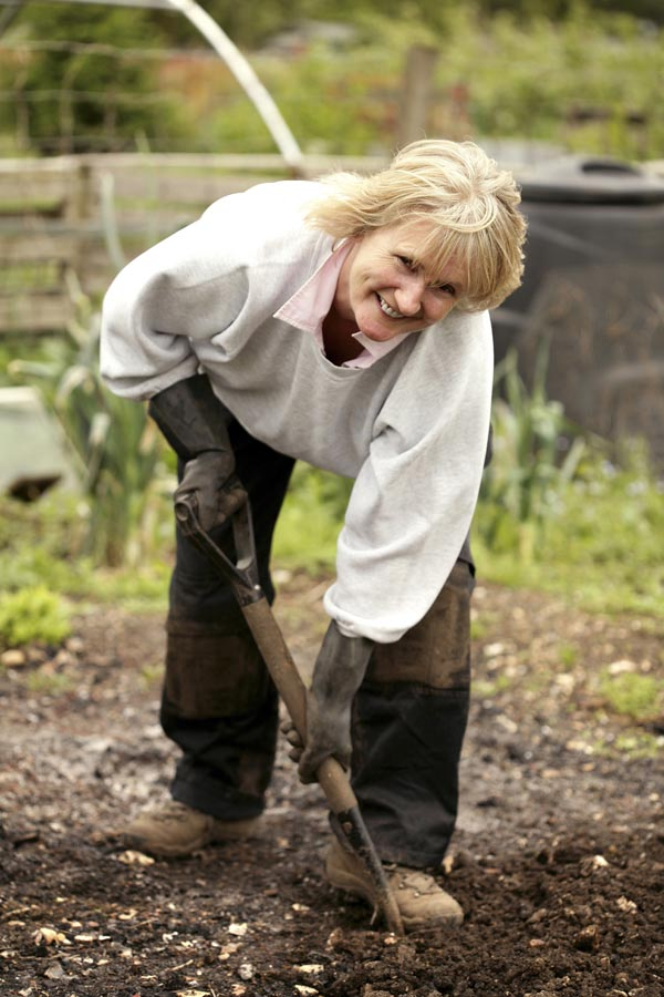 Lady shovelling soil